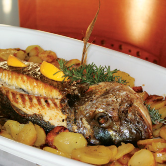 Baked gilthead in wine sauce